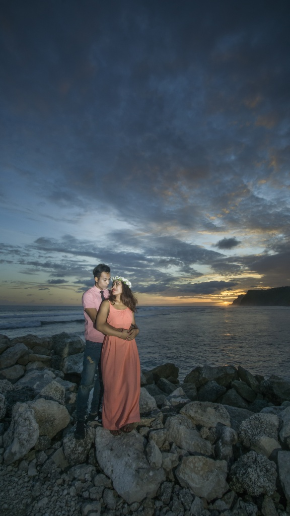 Romantic moment with sunset at Melasti Beach